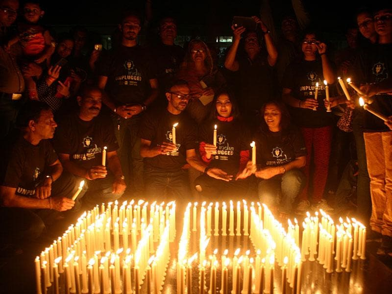 Residents of Bhopal lit up candles to observe Earth Hour on Saturday. (Bidesh Manna/HT photo)