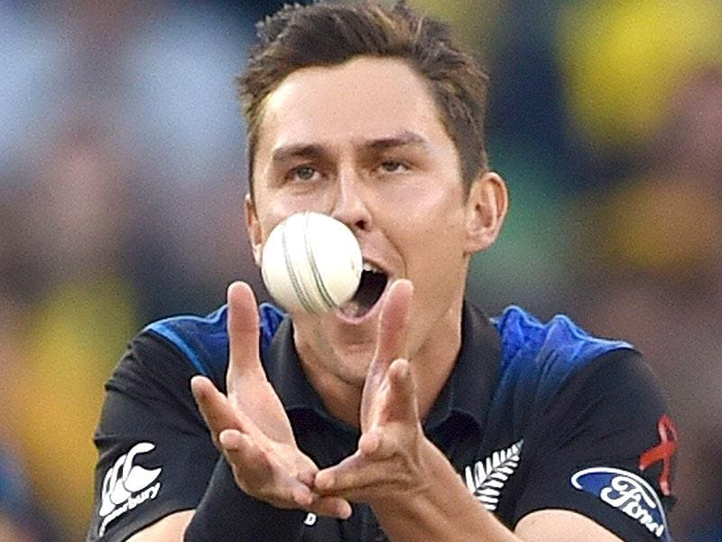 New Zealand bowler Trent Boult takes a catch off his own bowling to dismiss Australian batsman Aaron Finch during the 2015 Cricket World Cup final between Australia and New Zealand in Melbourne on March 29, 2015. AFP PHOTO