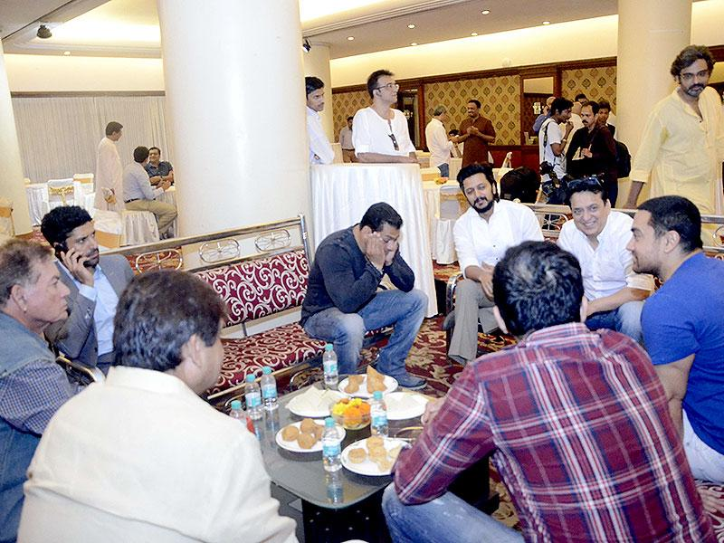Aamir Khan, Salman Khan, Farhan Akhtar and Riteish Deshmukh with filmmaker Sajid Nadiadwala and screenwriter Salim Khan during a seminar convened by MNS chief Raj Thackeray to discuss the controversial Mumbai Development Discussion (MDP) in Mumbai, on March 28, 2015. (Photo: IANS)