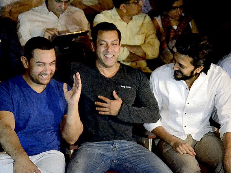 Aamir Khan, Salman Khan and Riteish Deshmukh share a light moment during a seminar convened by MNS chief Raj Thackeray to discuss the controversial Mumbai Development Discussion (MDP) in Mumbai, on March 28, 2015. (Photo: IANS)