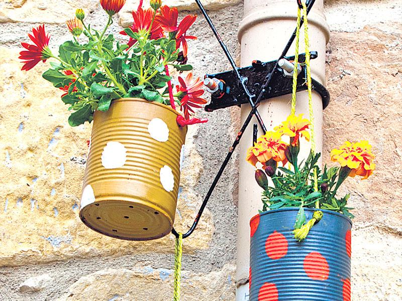 Hang 'em: This is possibly the easiest way to work around small spaces. Get small planters that can be hung with a wire or a beautiful L-bracket.Alternatively, you can get cans from your local market (especially the kinds milkmen still carry), paint them in bright, summery colours and just hang them over the balcony railing. You could even take one long rope and tie all your mini planters on it by making three to four knots. Easy-peasy.