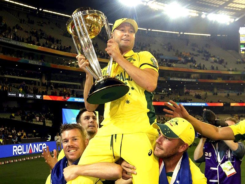 Australia's captain Michael Clarke (C) is carried on the shoulders of teammates David Warner (L) and Aaron Finch as he holds the Cricket World Cup trophy after they defeated New Zealand in the final match at the Melbourne Cricket Ground (MCG) March 29, 2015. (Reuters)