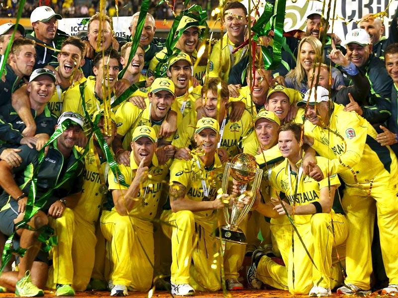 Australia's captain Michael Clarke holds the Cricket World Cup trophy as he celebrates with teammates and support staff after they defeated New Zealand in the final match at the Melbourne Cricket Ground (MCG). (Reuters)