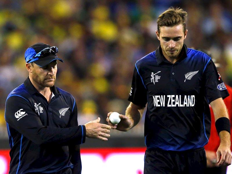 New Zealand's captain Brendon McCullum (L) hands the ball to bowler Tim Southee during the Cricket World Cup final match against Australia at the Melbourne Cricket Ground (MCG). (Reuters)