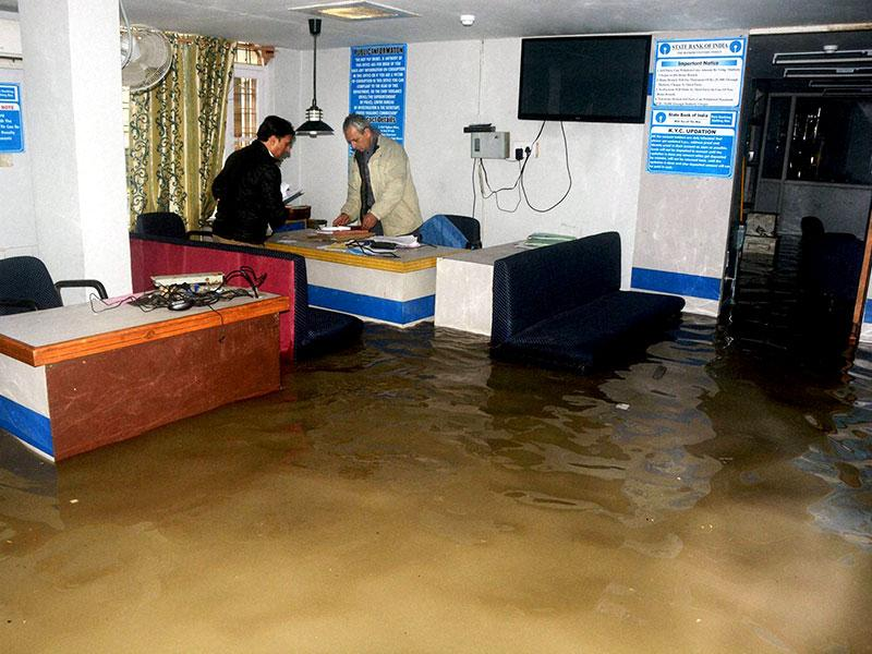 A bank partially under water at Badshah Chowk after the city received heavy rainfall, in Srinagar. (PTI Photo)