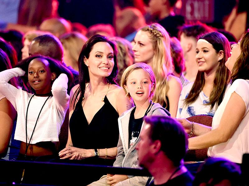 Angelina Jolie with daughters Zahara Marley Jolie-Pitt (L) and Shiloh Nouvel Jolie-Pitt (R) at Nickelodeon's 28th Annual Kids' Choice Awards where winners are doused with a jet of green slime. (AFP)