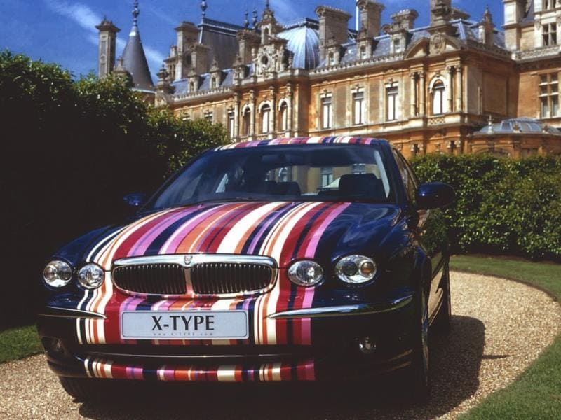 Paul Smith and Jaguar : It's by no means the first time that the designer has turned his attentions to an iconic British motoring marque. In 2001 Smith partnered with Jaguar (which like Land Rover was then part of the Ford Motor Company) to create a one-off X-Type for a charity auction aid of Macmillan Cancer Support. Although the car itself remained 'stock' inside the cabin and under the hood, the exterior paint job was truly unique and clearly a Paul Smith design with his signature multi-colored multi-stripe motif running from nose to tail via the roof. The other unique addition was a personalized numberplate, P5 JAG. Photo:AFP