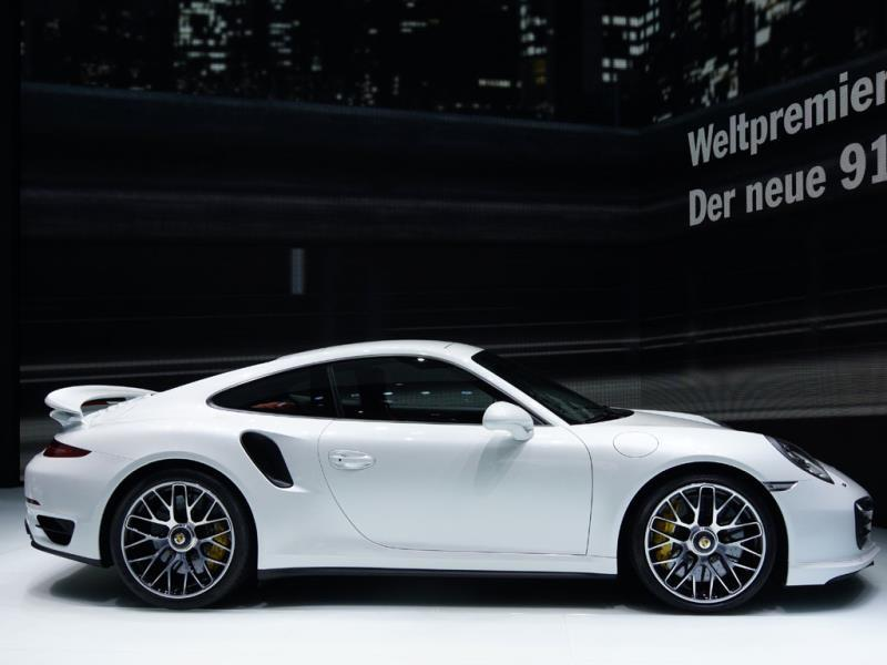 The Porsche 911 Turbo S : Rear-engined, and with four-wheel drive, the Porsche also has a 3.8-liter twin turbo engine, but it's a flat six, rather than a V8 for a lower center of gravity. It can develop 552bhp, which translates into a 0-100km/h time of 3.1 seconds - so it's a fraction quicker off the line but with a top speed of 'just' 312km/h it can't claim to be a member of the 200mph club. Photo:AFP
