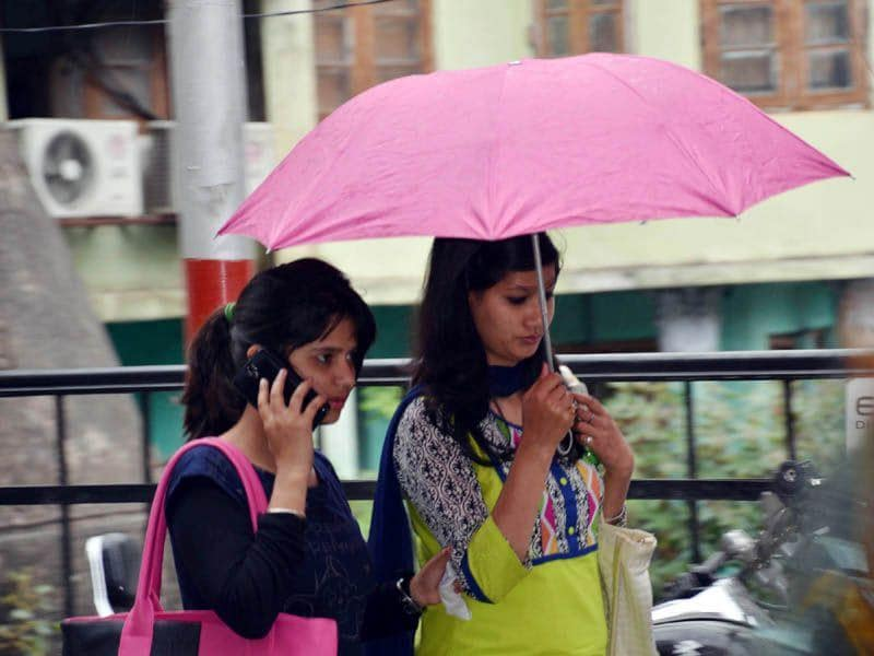 Girls walking in rain in Mandi.HT/Photo