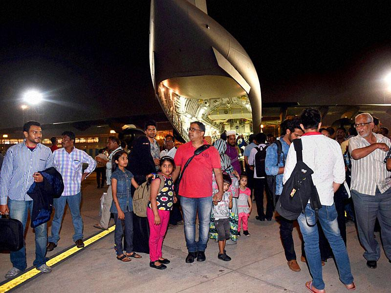 190 among the 358 Indians who were stranded in Yemen alight from the Indian Air Force C17 (Globemaster) aircraft after being evacuated from Djibouti, at the International Airport in Mumbai. PTI Photo