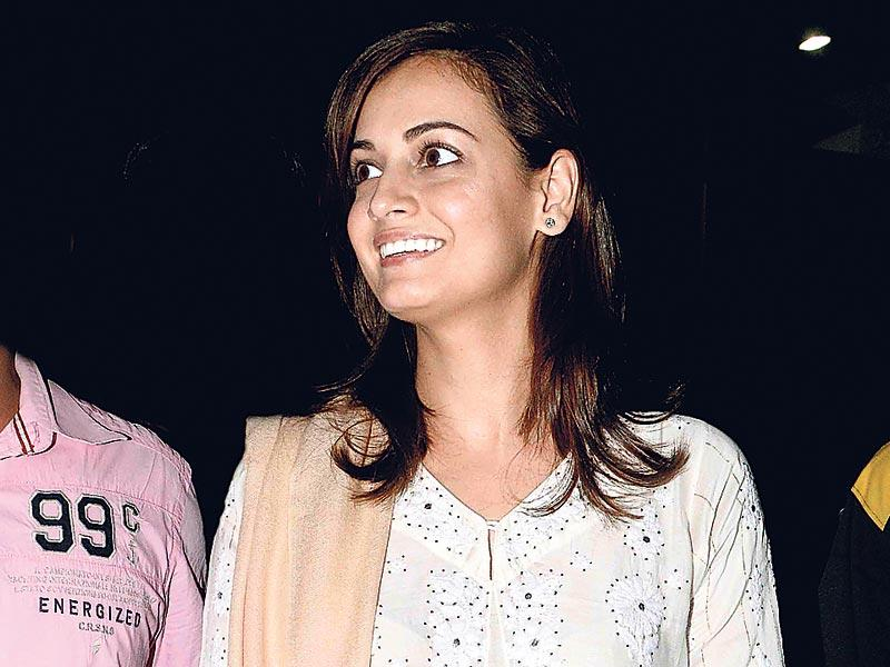 Dia Mirza smiles for the cameras at a Mumbai event. (HT photo)