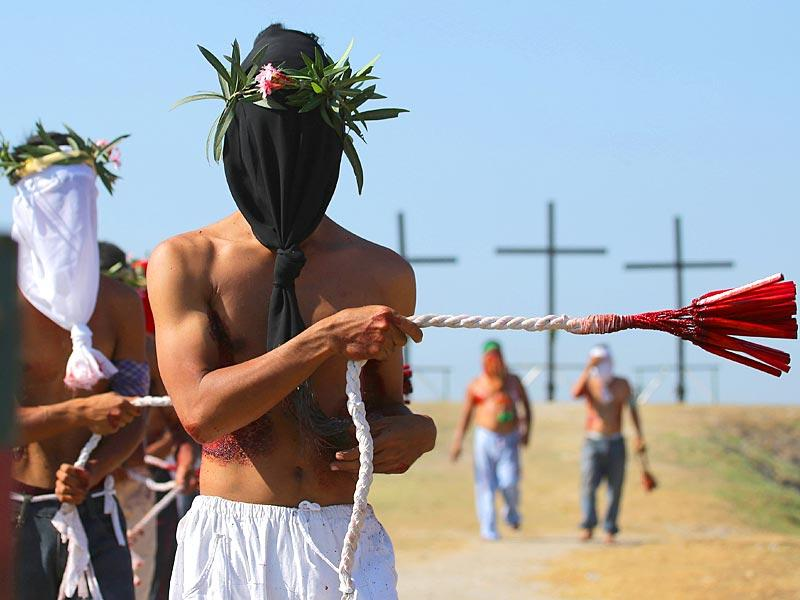 Hooded Filipino penitents flagellate during Good Friday rituals to atone for sins on Friday, April 3, 2015 in Pampanga province, northern Philippines. AP Photo