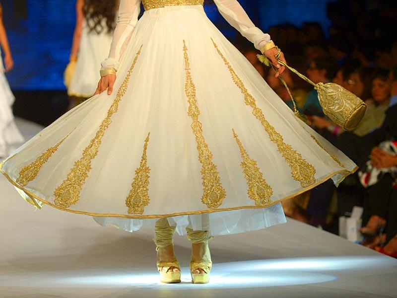 A model presents a creation by designer Gul Ahmed. (Photo: AFP)