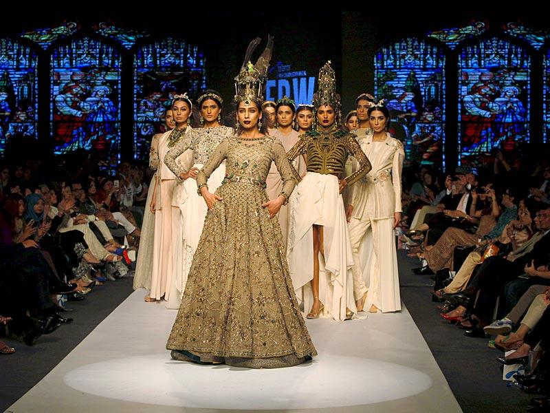 Models don designs by Pakistani designer Fahad Hussayn. (Photo: Reuters)