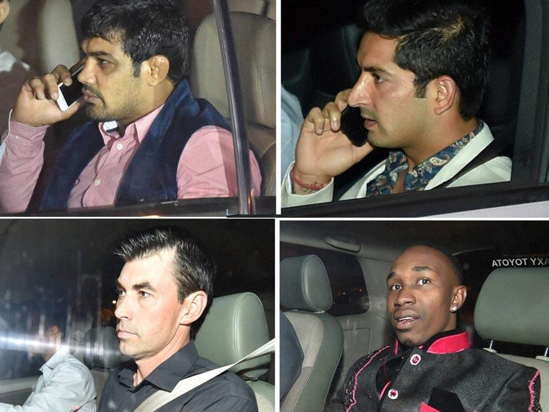 A combination of photographs of wrestler Sushil Kumar, cricketers Mohit Sharma, Stephen Fleming and Dwayne Bravo during the wedding ceremony of cricketer Suresh Raina. (PTI Photo)