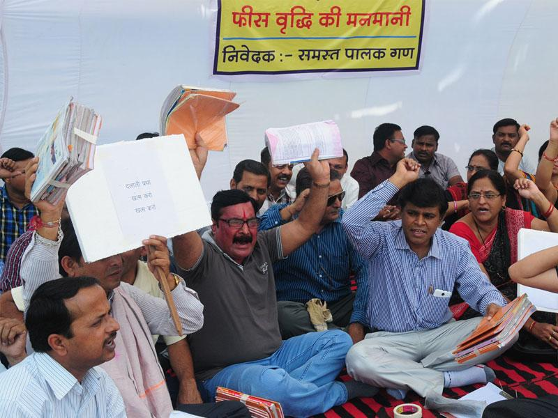 Parents protest against alleged hegemony of private school owners over fee hike in Bhopal. (Mujeeb Faruqui/HT file photo)
