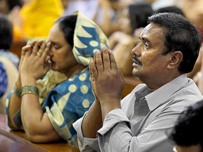 A Catholic devotee cries as he prays during Easter mass inside the Sacred Heart Cathedral in New Delhi. (AP Photo)
