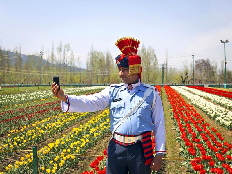 A Jammu and Kashmiri state traffic policeman takes a