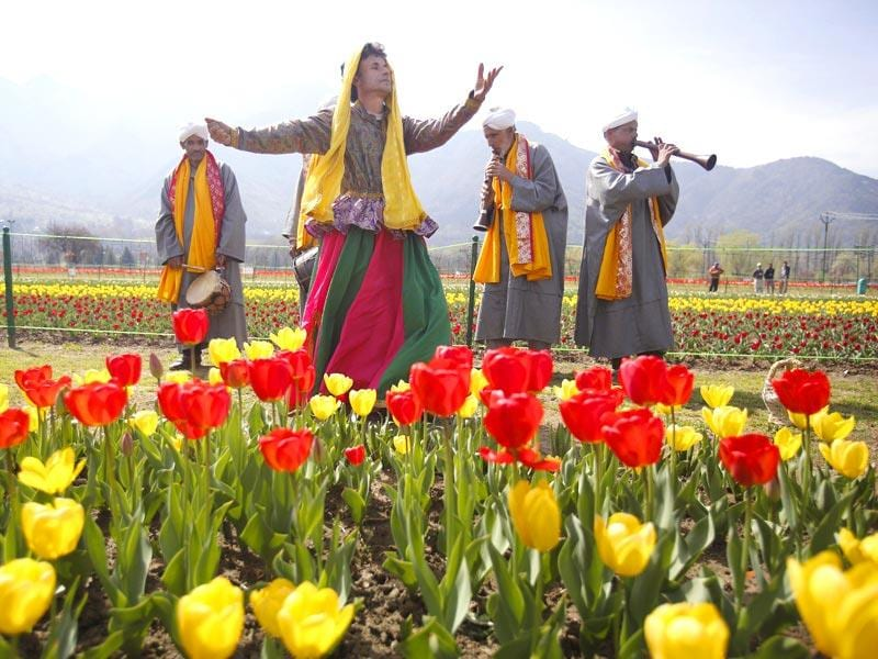 Kashmiri traditional folk dancers perform during the season's opening of Siraj Bagh, claimed to be the largest tulip garden in Asia, on Zabarwan Hills in Srinagar. (AP Photo)