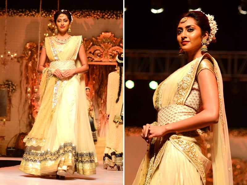 A Model walks the ramp in a shimmery off white outfit by fashion designer Vikram Phadnis at Wedding Fair 2015 in Mumbai. (IANS)