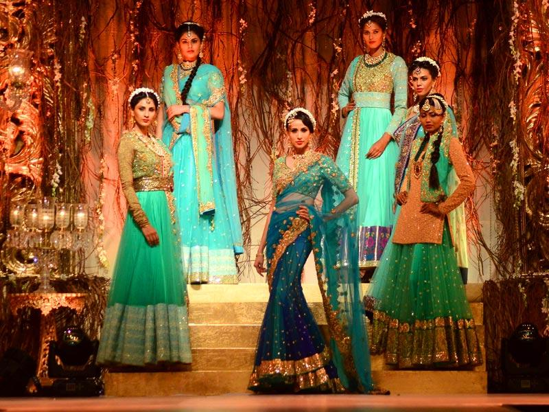 Models showcase saris, anarkalis, lehengas and lachhas designed by one of Bollywood's favourite designers, Vikram Phadnis, at Wedding Fair 2015 in Mumbai. (IANS)