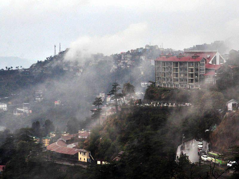 Fog engulfed the 'Queen of Hills,' as rainfall lashed the city on Tuesday. Santosh Rawat/HT