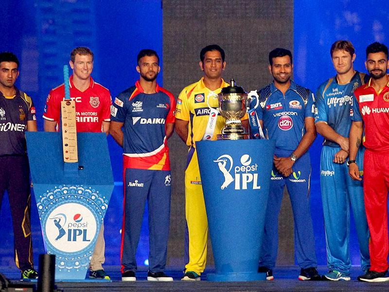 Captains of the IPL teams pose with the trophy during the IPL 2015 opening ceremony at Salt Lake Stadium in Kolkata. (PTI Photo)