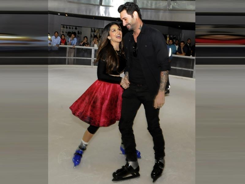 Sunny Leone and her husband Daniel Weber ice skate during the promotion of her next film,Ek Paheli Leela. The actor plays three different roles in the film. (HT photo)