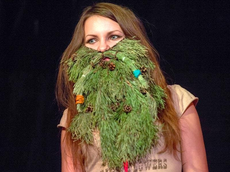 Moscow: A woman wearing branches of plants poses during Russia's beard and mustaches championship in central Moscow on April 4.