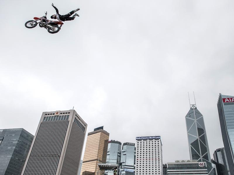Hong Kong: A motocross pilot performs a stunt jump in front of the city's skyline during a promotional event for an energy drink in Hong Kong on April 3. The famous city's skyline is often used as part of the promotional events by various brands and organizations.