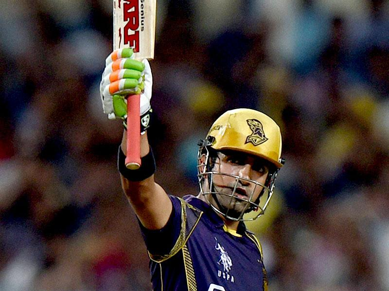 Kolkata Knight Riders captain Gautam Gambhir raises his bat after completing his half-century during the IPL 2015 match between Kolkata Knight Riders and Mumbai Indians at Eden Gardens in Kolkata. (PTI Photo)