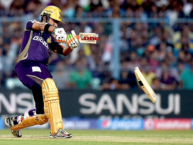 Gautam Gambhir's bat breaks as he plays a shot during Kolkata Knight Riders' IPL 2015 match against Mumbai Indians at Eden Gardens in Kolkata. (PTI Photo)