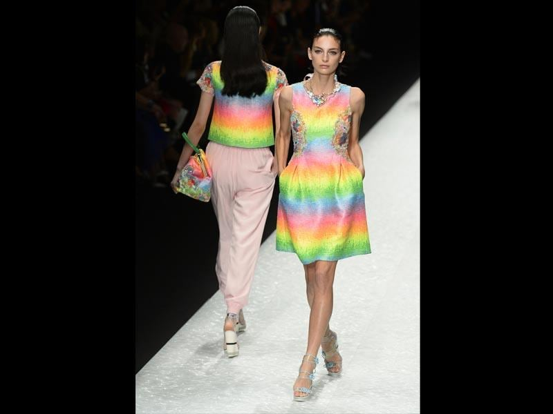 Neon and denim jackets: Though neon is mostly reserved for restrained accents, some labels didn't hesitate to make it the star of a look. That was the case with Shiatzy Chen, which presented a series of neon rainbow dresses and tops. It remains an exception though, as the 2015 spring/summer season will be more restrained than its predecessors. Just like the overall, the denim jacket is making a comeback (denim in general is on the rise), but embroidered or decorated with patterns for a more subtle look than in the 90s.