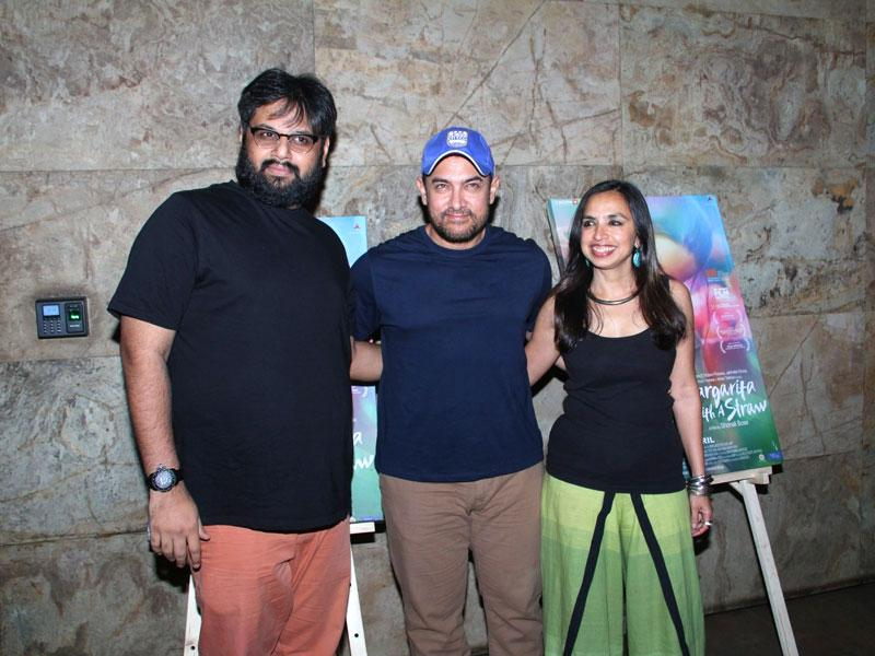 Filmmakers Nilesh Maniyar and Sonali Bose with actor Aamir Khan during the special screening of film Margarita With A Straw in Mumbai on April 8, 2015. (Photo: IANS)