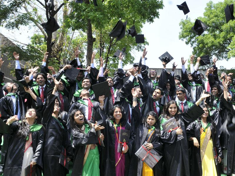 Indian Institute of Forest Management passout students toss caps in jubilant mood during convocation ceremony in Bhopal on Thursday. (Mujeeb Faruqui/HT photo)