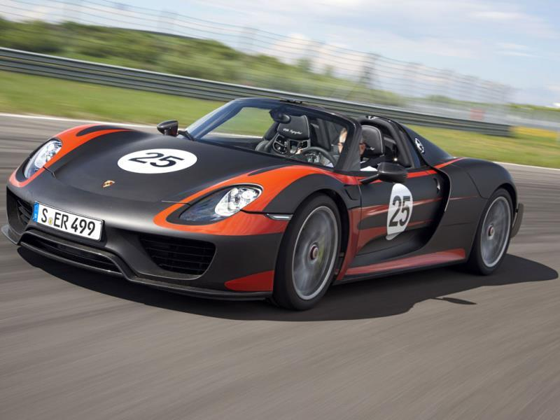 Porsche 918 Spyder: 9.8 sec @ 145 mph (233 kph) : You wait a generation for a hybrid supercar to arrive then three turn up at once. Unlike the Ferrari or the McLaren, the Porsche also offers four-wheel drive and drop-top motoring, thanks to a removable roof panel. Photo:AFP