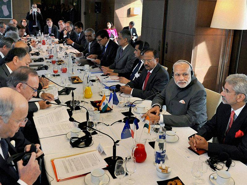 Prime Minister Narendra Modi with French CEOs during the round table meeting on infrastructure in Paris on Friday. (PTI Photo)