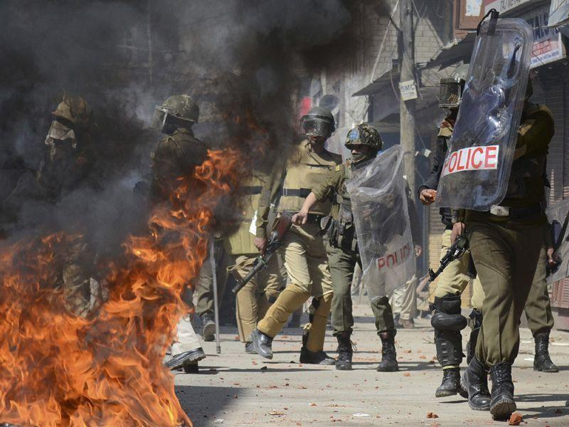 PoliPolicemen trying to control the angry protesters in Srinagar on Friday. Protests and clashes erupted against government plan to build townships for displaced Kashmiri Pandits. Waseem Andrabi/ HTAndrabi/ HT