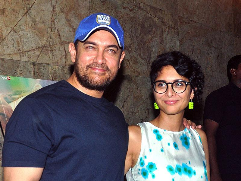 Aamir Khan with wife & film director Kiran Rao attend a special screening of upcoming Hindi film 'Margarita with a straw', written and directed by Shonali Bose, (R), in Mumbai on April 8, 2015. (AFP Photo)