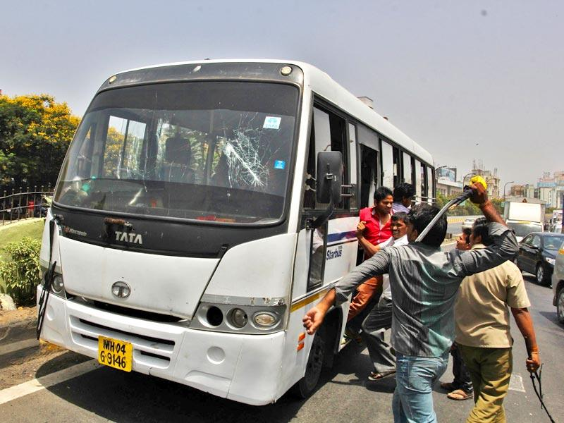 Autorickshaw unions in Thane staged a flash strike and a massive protest. The protesters threw stones and vandalised private buses, bringing the city to a standstill for around seven hours.(Praful Gangurde/HT photo)