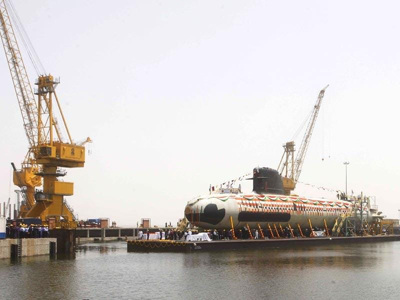 India's first Scorpene submarine, which can carry 18 torpedoes and travel 1,020 kilometres underwater, was floated at the Mazagon Docks in Mumbai. (Pratham Gokhale/HT photo)