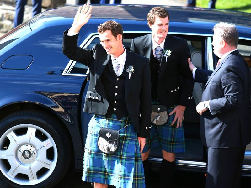Britain's Andy Murray arrives for his wedding to Kim Sears, with his brother Jamie, center, at Dunblane Cathedral in Scotland. (AP Photo/PA, Andrew Milligan)