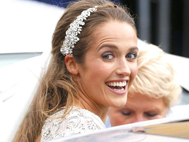 Kim Sears smiles as she leaves after marrying tennis player Andy Murray at the cathedral in Dunblane, Scotland. REUTERS/Russell Cheyne TPX IMAGES OF THE DAY