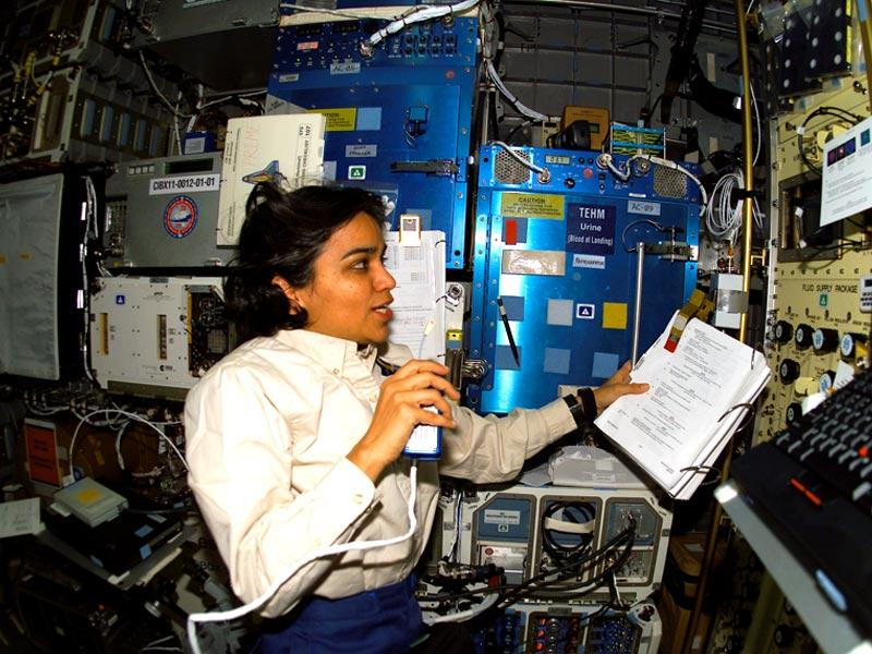Human space flight day | Taken on 26 January 2003 | Astronaut Kalpana Chawla, STS-107 mission specialist, records data. Photo: NASA