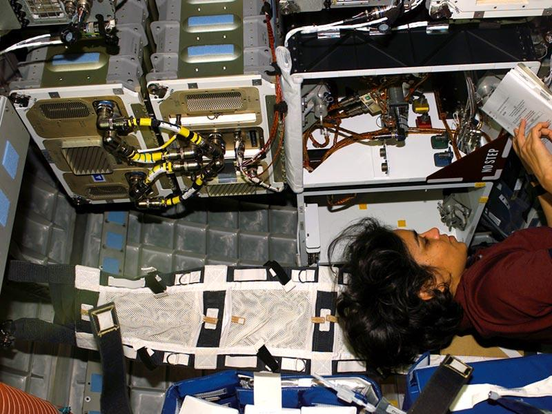 Human space flight day | Taken on January 18 2003, Astronaut Kalpana Chawla, mission specialist, works at an experiment rack in the SPACEHAB Research Double Module onboard the Space Shuttle Columbia.