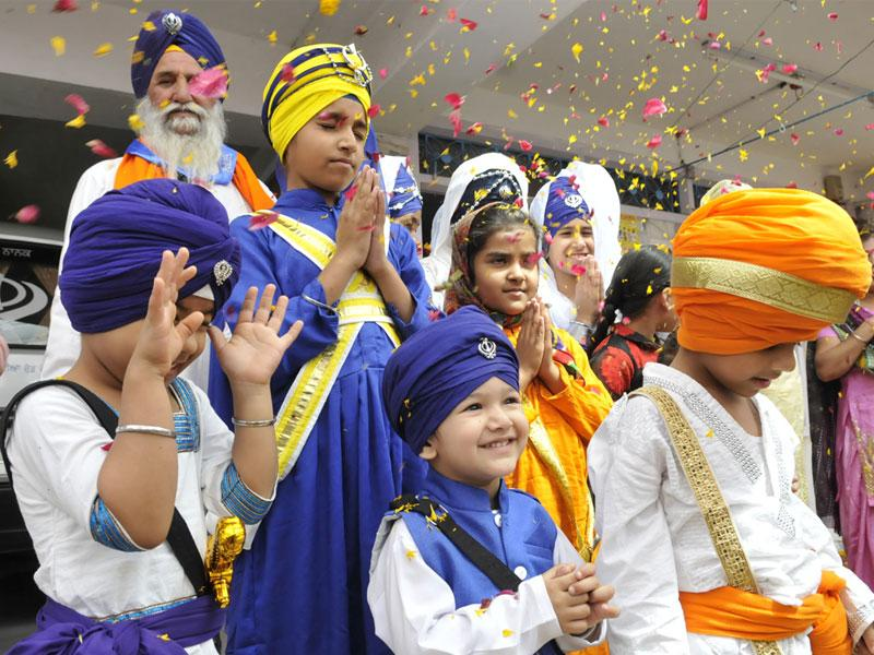 Sikh children take part in a programme organised as part of Baisakhi celebrations at Gurdwara Nanaksar, in Bhopal on Sunday. (Mujeeb Faruqui/HT photo)