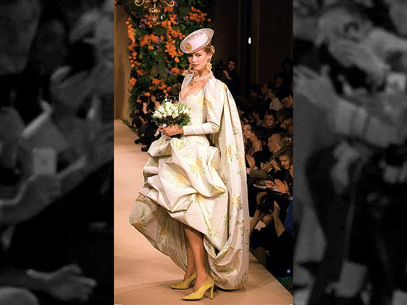 1997: A wedding gown in a white and gold floral print fabric from the Yves Saint Laurent haute couture spring-summer 1997 collection.