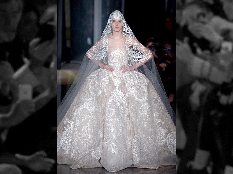 2013: An elaborately embroidered wedding gown worn with its stunning veil, from the Elie Saab haute couture spring-summer 2013 collection.