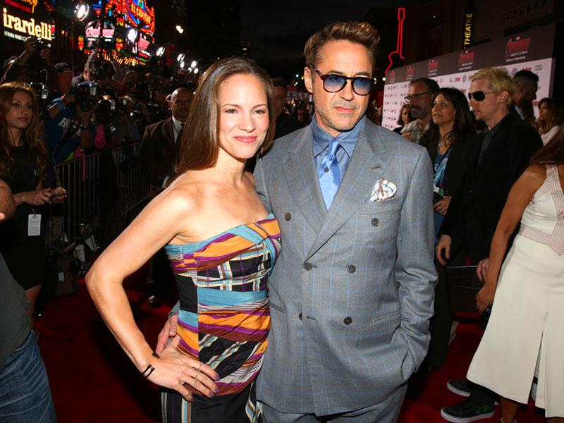 The Iron Man has arrived, as always in style: Susan Downey, left, and Robert Downey Jr. arrive at the Los Angeles premiere of Avengers: Age Of Ultron. (AP photo)