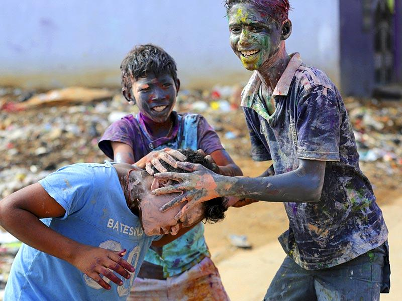 Children smear each others face with coloured paint during Puthandu celebrations in Bangalore. Puthandu or the Tamil New Year is celebrated by Tamils across the world. (AP Photo)